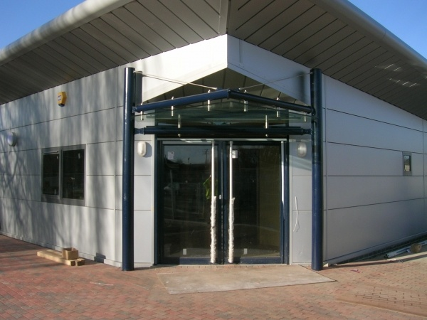 This small entrance porch canopy at The Driving Standards Test Centre follows the roofline and provides weather protection for people using our sleek ... & Canopies porches lobbies and shelters | Anglian Architectural Ltd