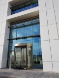 Revolving Door and Brise Soleil Fixed Back to the Curtain Wall
