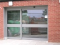 Large single auto sliding entrance door to NHS Trust